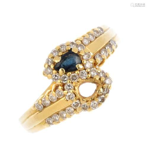 An 18ct gold sapphire and diamond crossover ring. The pear-shape sapphire, with brilliant-cut