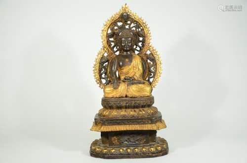 A PARCEL GILT-DECORATED BUDDHA  AND BASE