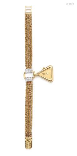 Ref: 5109 1, Circa 1980  Chopard for Kutchinsky. A lady's unusual form 18K gold and diamond set manual wind pendant bracelet watch