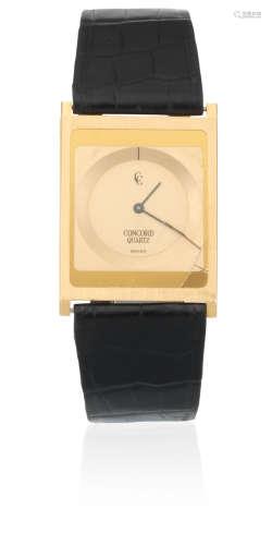 Circa 1990  Concord. An 18K gold ultra-thin quartz rectangular wristwatch