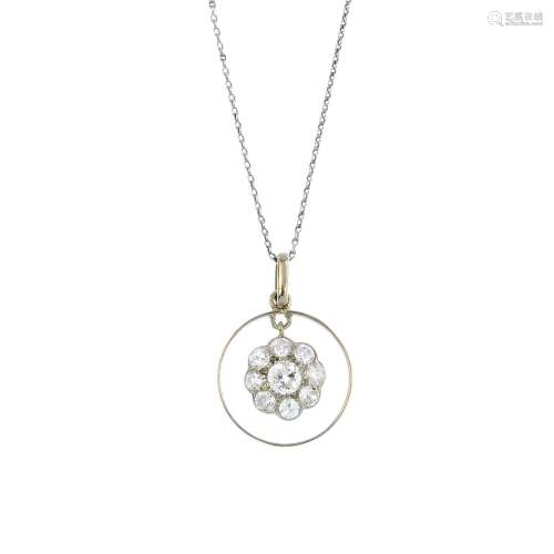 A diamond pendant. The brilliant and circular-cut diamond cluster, suspended within a halo, to the
