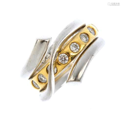 GEORG JENSEN - two 18ct gold and diamond 'Magic' rings. The brilliant-cut diamond band ring,