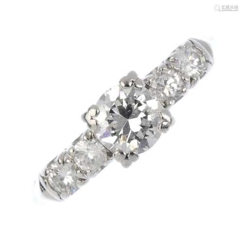 A diamond ring. The brilliant cut diamond, with similarly-cut diamond line sides. Principal