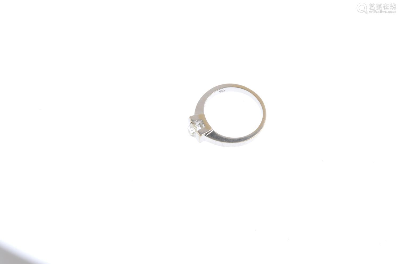 A diamond single-stone ring. The old-cut diamond, tension-set to the plain band. Estimated diamond
