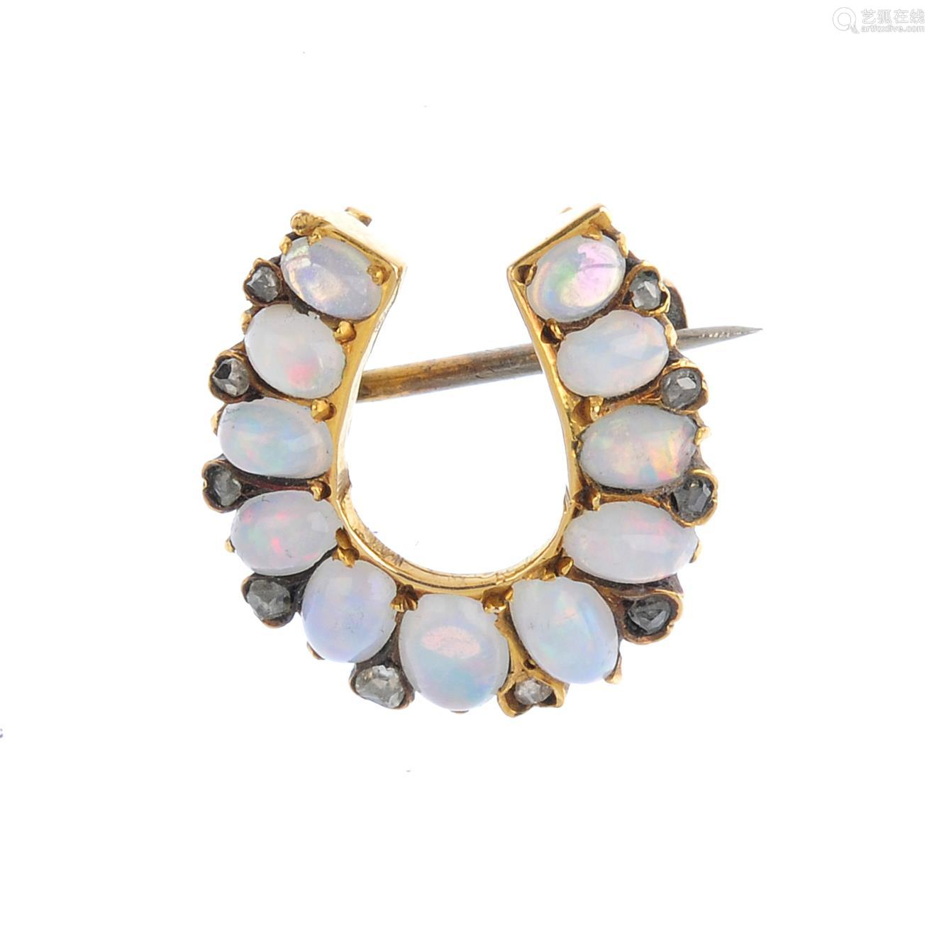 A late Victorian 15ct gold, opal and diamond horseshoe brooch. The graduated oval opal cabochon