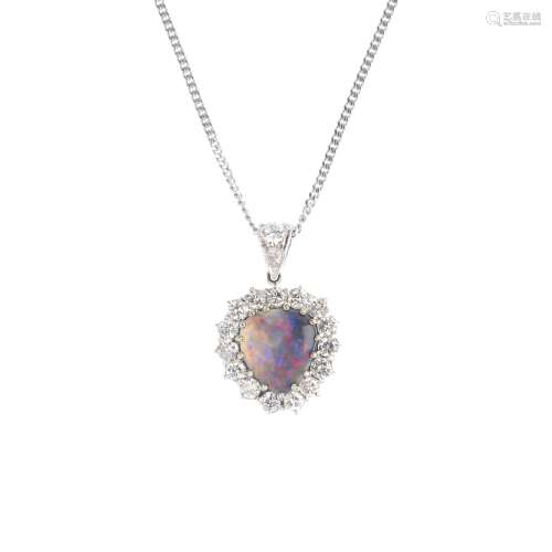 An 18ct gold black opal and diamond heart pendant. The black opal cabochon, with brilliant-cut