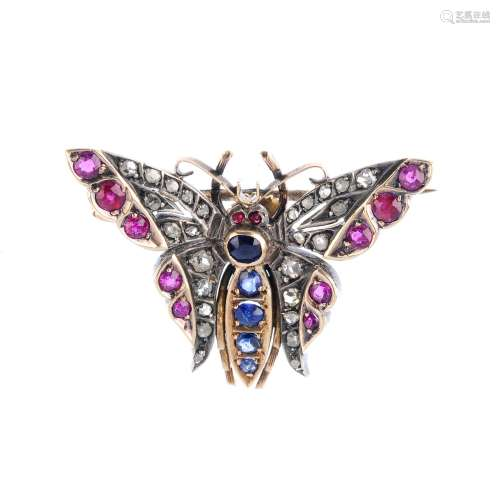 A late Victorian silver and gold diamond and gem-set butterfly brooch. With circular-shape