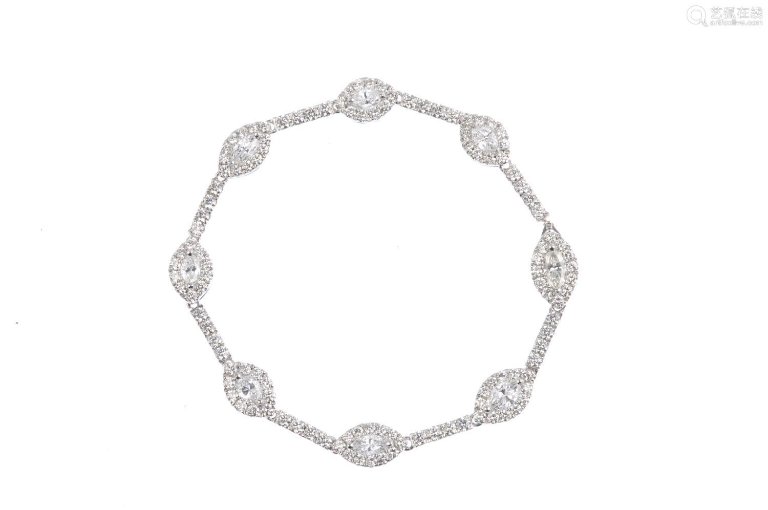 A diamond bracelet. Designed as a series of marquise-shape diamond links, each with brilliant-cut