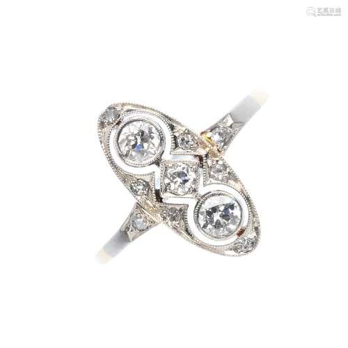 An early 20th century diamond dress ring. The vari-size, circular-cut diamond geometric line, all