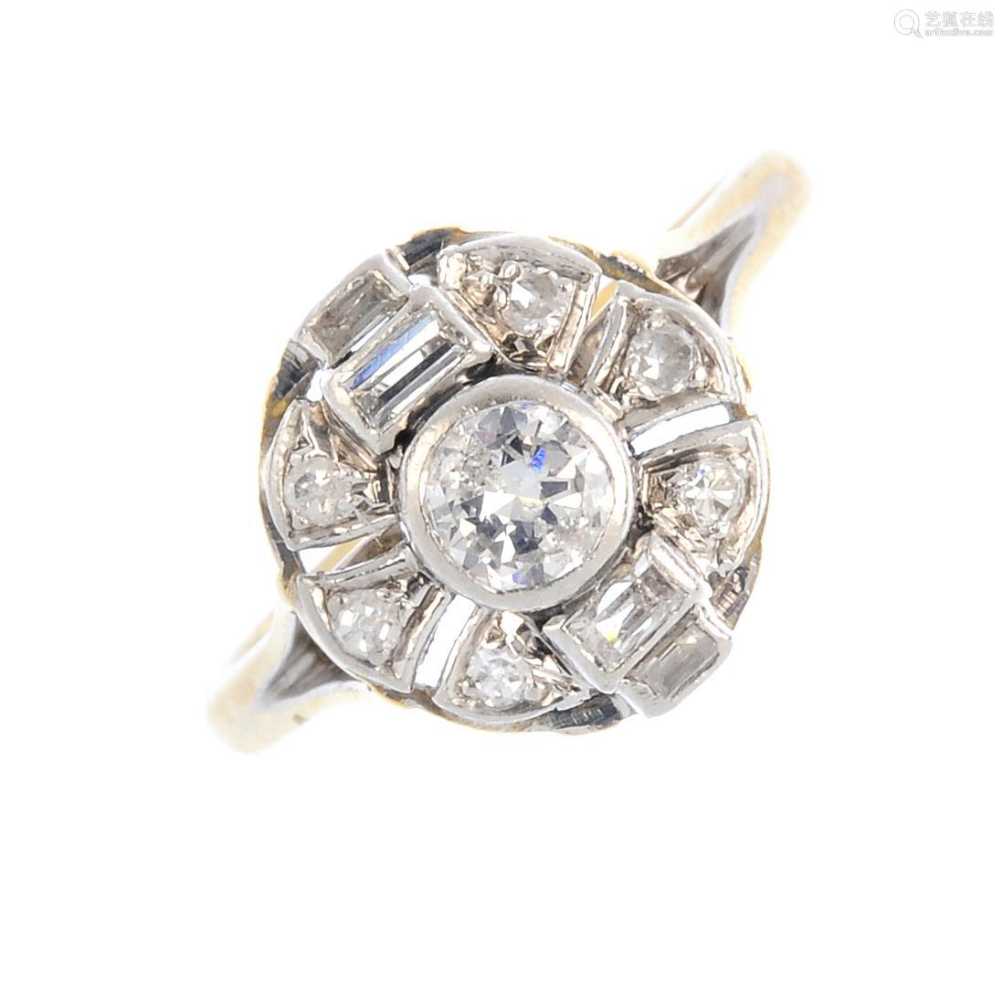 A diamond cluster ring. The brilliant-cut diamond, with baguette-cut diamond sides and single-cut