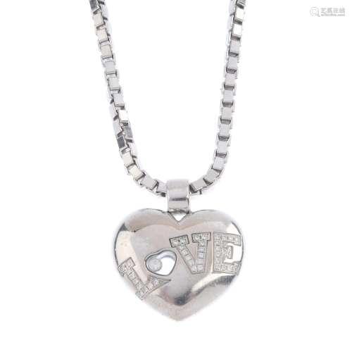 CHOPARD - an 18ct gold diamond 'Love' pendant. Designed as a heart, with brilliant-cut diamond '