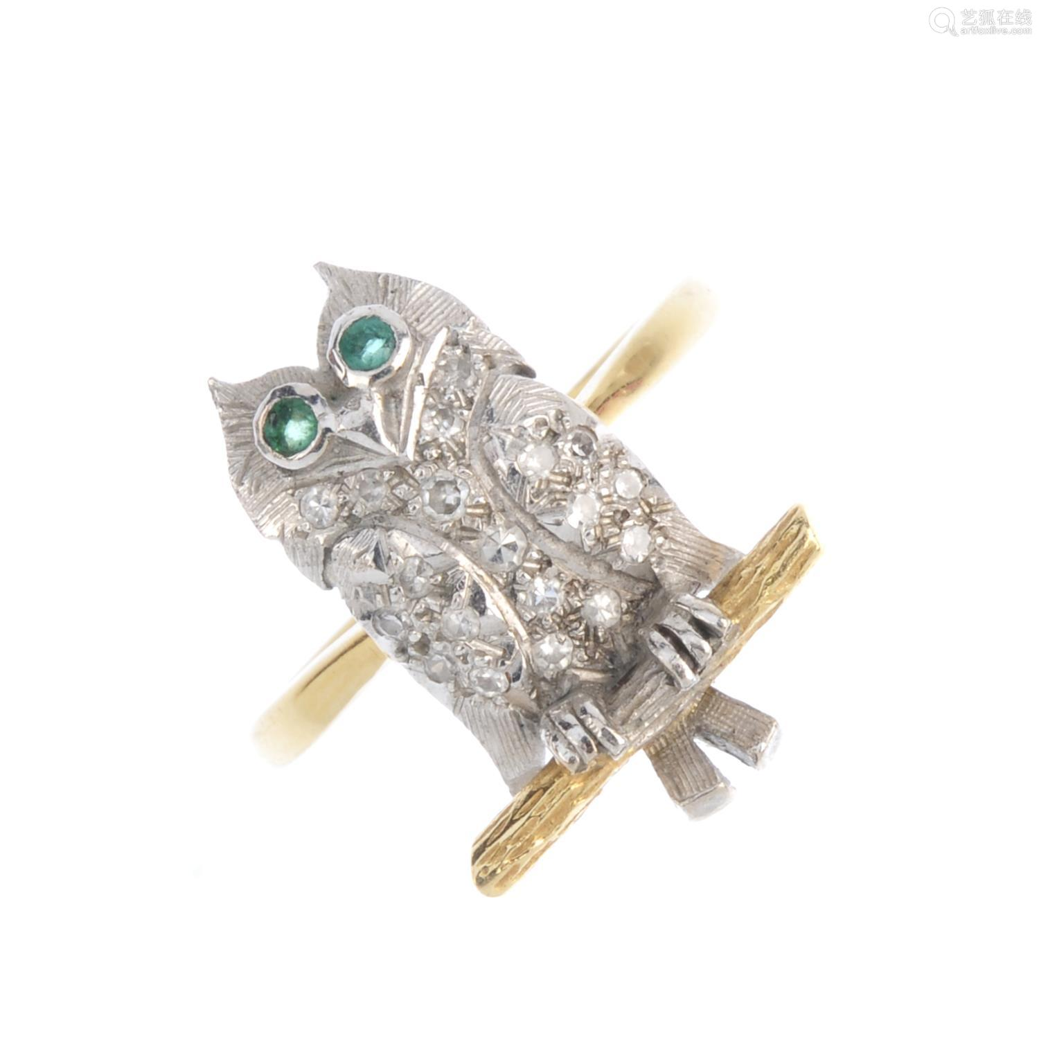 A diamond owl ring. The single-cut diamond owl, with circular-shape emerald eyes, perched upon a