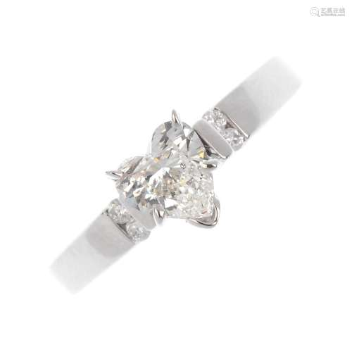 A diamond ring. The heart-shape diamond, weighing 0.70ct, with brilliant-cut diamond line shoulders.