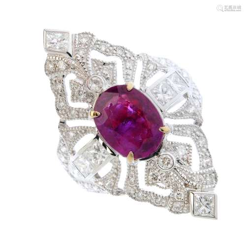 A ruby and diamond dress ring. Of openwork design, the oval-shape ruby, set atop a vari-cut