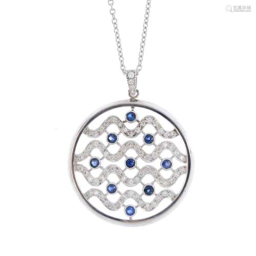 A diamond and sapphire pendant. Of circular outline, the undulating brilliant-cut diamond lines,