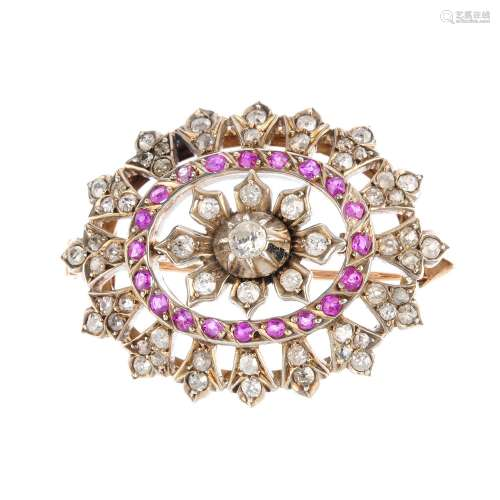 A late 19th century silver and gold, ruby and diamond brooch. Of oval outline, the vari-cut