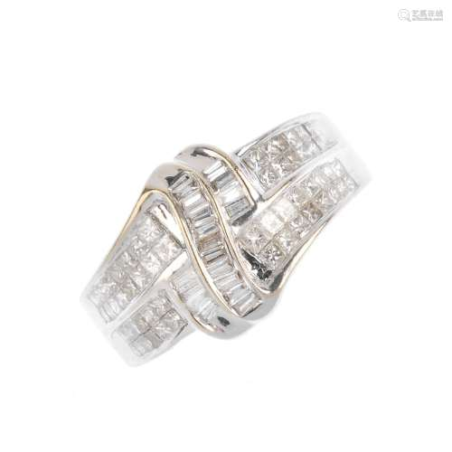 A diamond dress ring. Designed as a series of baguette-cut diamond scrolling lines, with square-
