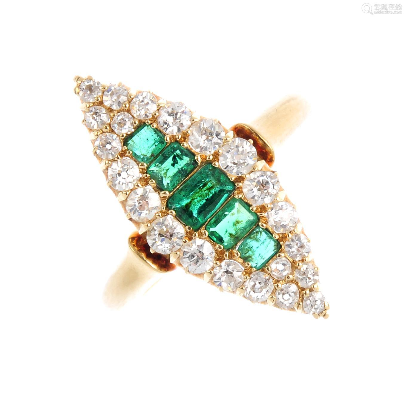 An Edwardian 18ct gold emerald and diamond cluster ring. Of marquise-shape outline, the graduated
