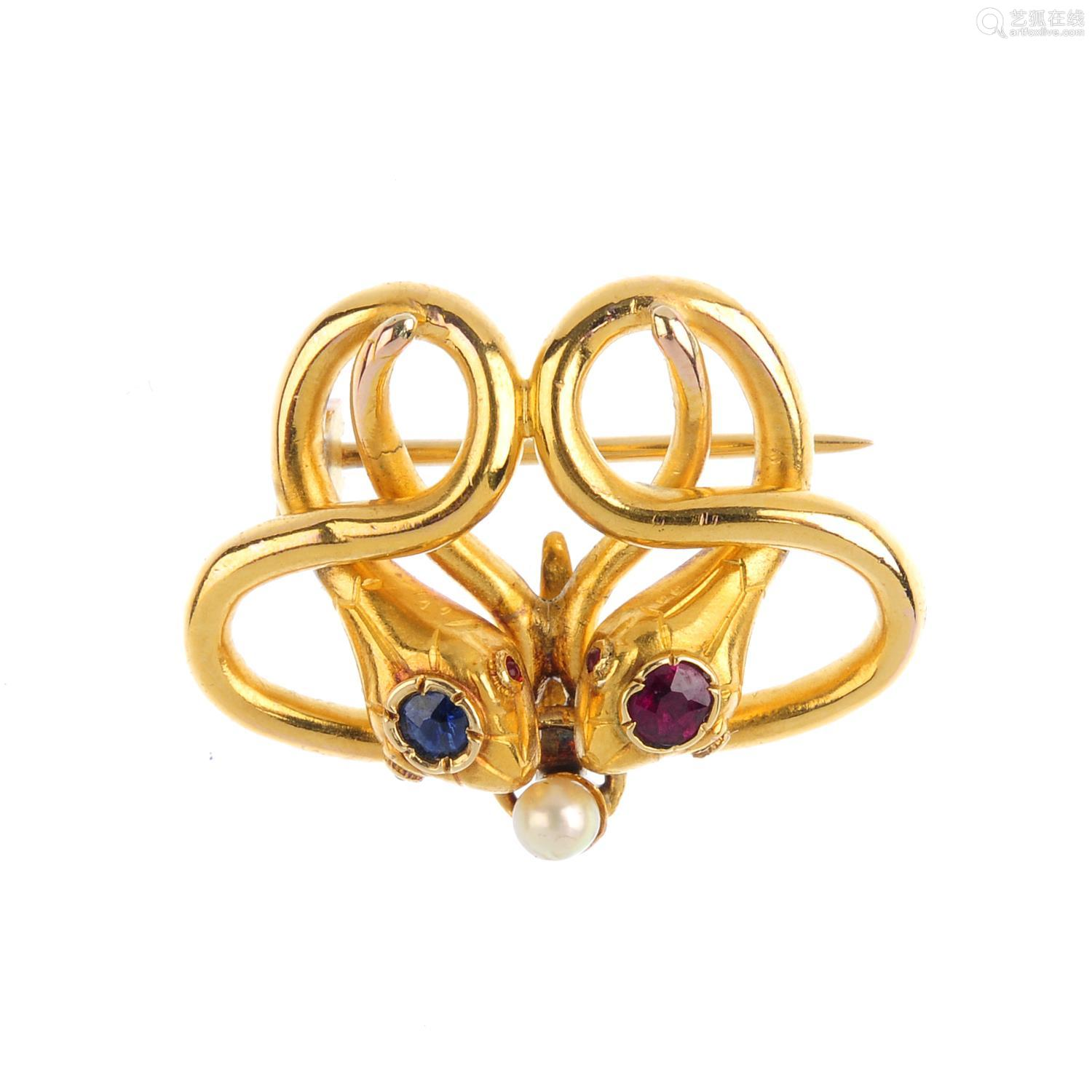 A late Victorian 18ct gold gem-set snake brooch. Designed as two snakes, with cushion-shape ruby