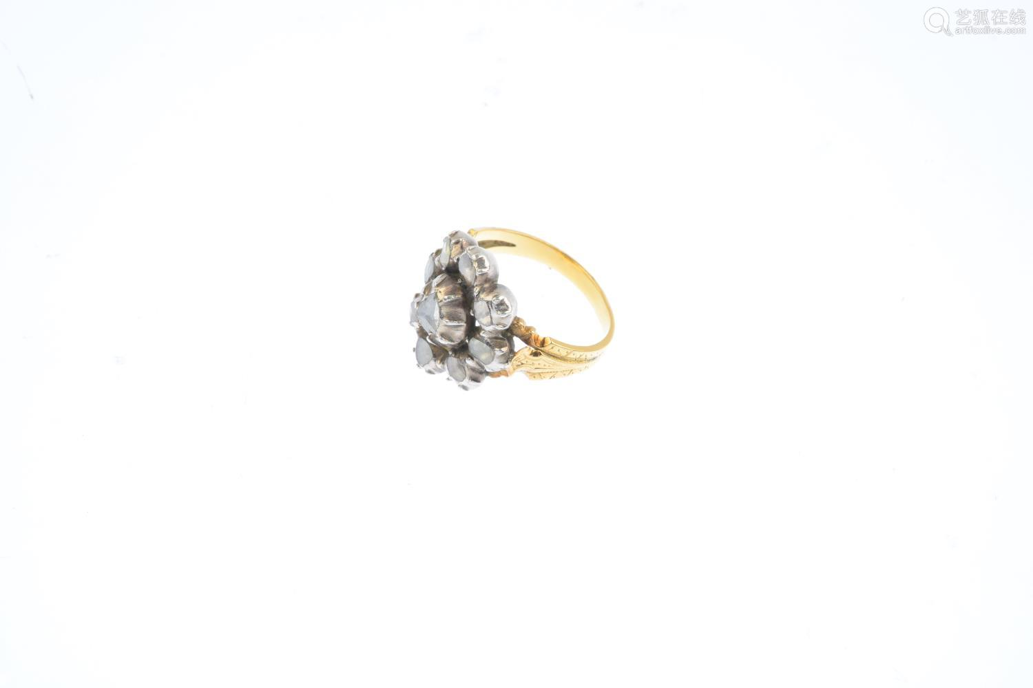 A late Georgian silver and gold diamond ring. The rose-cut diamond floral cluster, to the