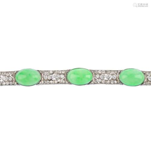 A jade and diamond bracelet. Comprising a series of five oval jadeite cabochons, with brilliant