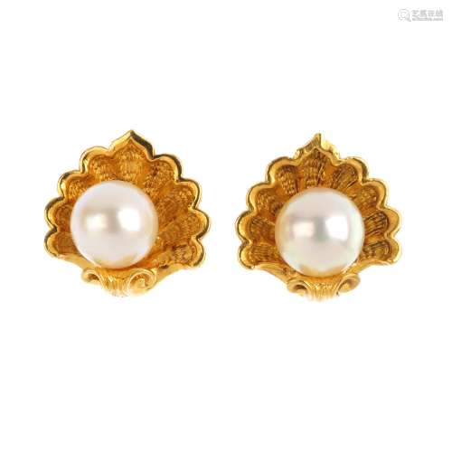 GARRARD - a pair of 18ct gold cultured pearl earrings. Each designed as a cultured pearl, within a