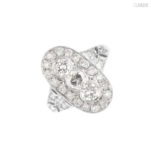 A diamond dress ring. The brilliant-cut diamond oval-shape cluster, with similarly-cut diamond
