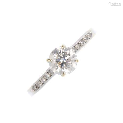 A 14ct gold diamond single-stone ring. The brilliant-cut diamond, weighing 0.70ct, with similarly-