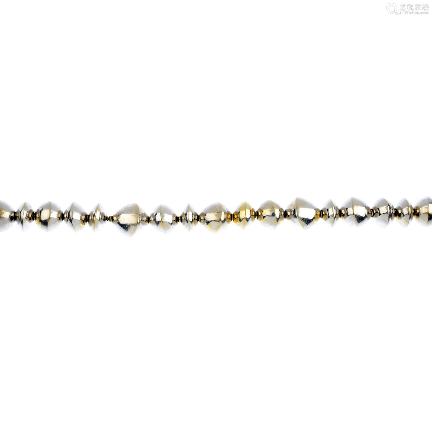 A bracelet. Comprising a series of vari-width beads, each tapered to an asymmetric knife-edge