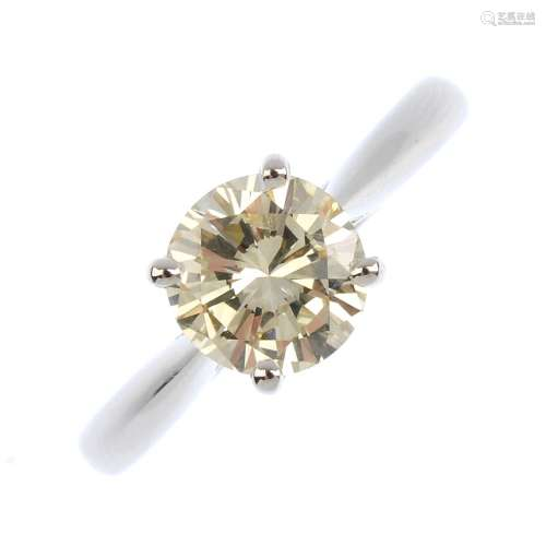 An 18ct gold diamond single-stone ring. The brilliant-cut diamond, with tapered shoulders and