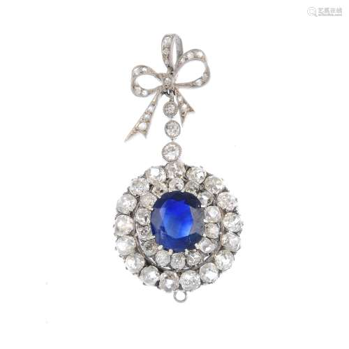 A sapphire and diamond pendant. The cushion-shape sapphire and old-cut diamond graduated