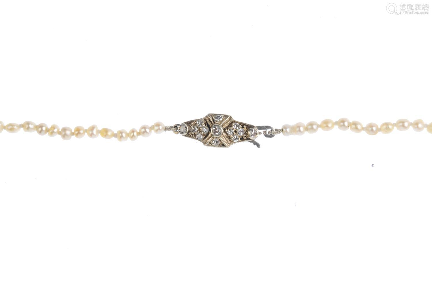 A natural pearl single-strand and diamond necklace. Comprising a single-strand of 137 pearls,