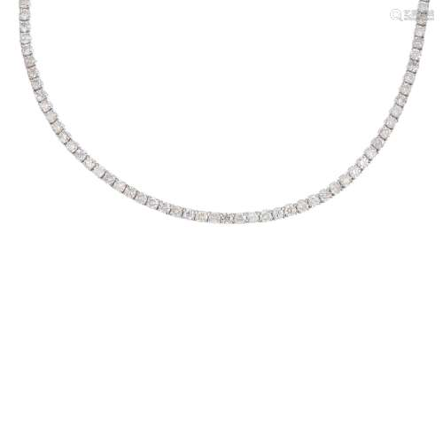 A diamond line necklace. Comprising a series of brilliant-cut diamonds, to the partially concealed