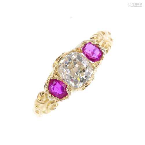An early 20th century gold, diamond and ruby three-stone ring. The old-cut diamond, with oval-
