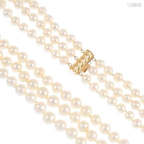 A cultured pearl three-row necklace. Comprising three graduated cultured pearl strands, measuring