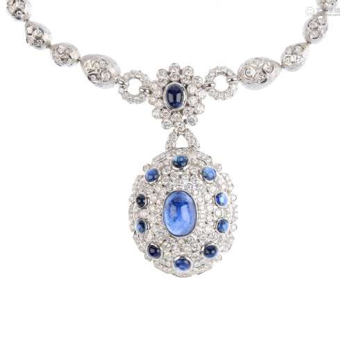 A sapphire and diamond necklace. The oval sapphire cabochon with brilliant-cut diamond and