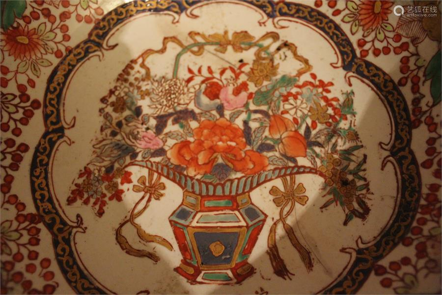 A Chinese enamelled porcelain bowl, painted in overglaze colours and underglaze blue and densely