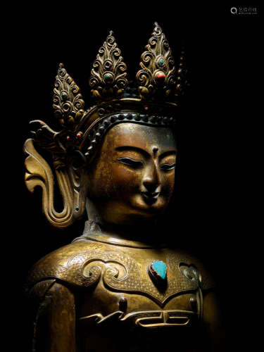DOLONNOR, QING DYNASTY, 18TH CENTURY A GILT COPPER ALLOY CAST AND REPOUSSÉ FIGURE OF CROWNED BUDDHA