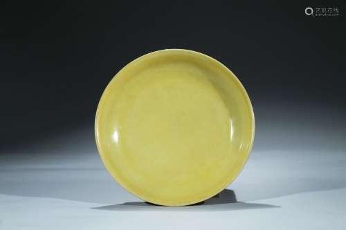 A large yellow glazed dish