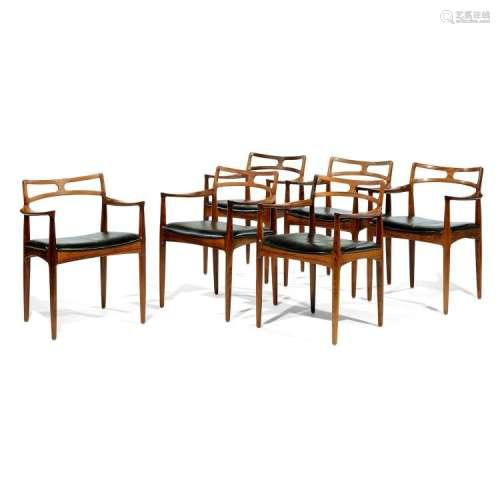 JOHANNES ANDERSEN (1903-1995) & CFC SILKEBORG (ÉDITEUR) Suite de six fauteuils en palissandre, piétement fuselé, accotoirs détaché...