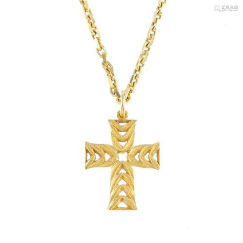 CASSANDRA GOAD - an 18ct gold cross pendant. Of