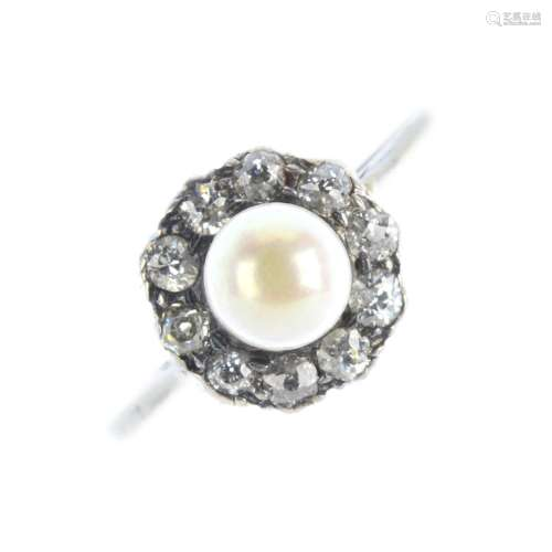 A pearl and diamond cluster ring. The pearl, measuring