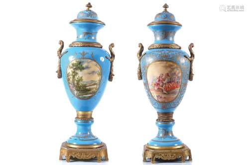 PAIR OF LARGE ORMOLU MOUNTED URNS AND COVERS