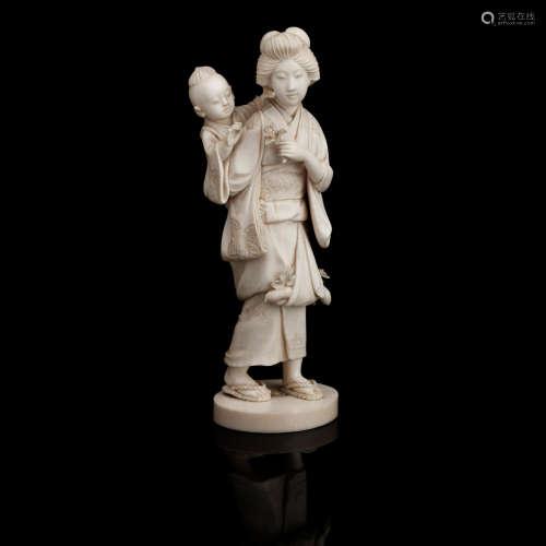 By Sangyoku, Meiji era A carved ivory okimono of a lady and child