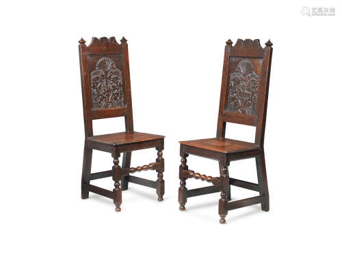 An interesting pair of Charles II joined oak backstools, Lancashire, circa 1680