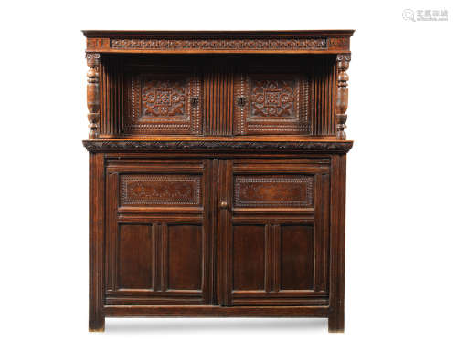 A James I joined oak court cupboard, West Country, dated 1620