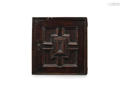 A Charles II joined and boarded fruitwood and oak table spice cupboard, circa 1670