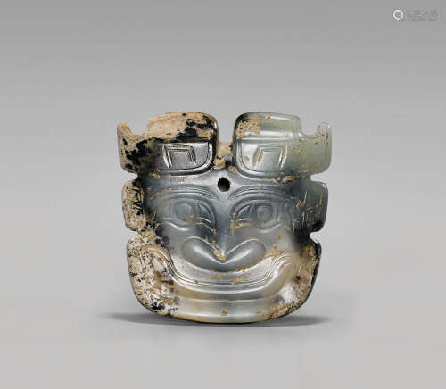 SHANG DYNASTY CARVED JADE MASK PENDANT