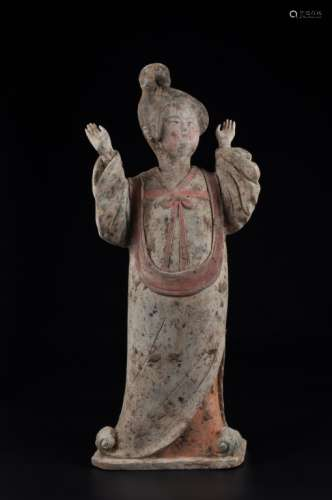 A POTTERY FIGURE OF A LADY