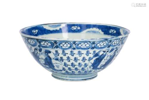 A blue and white 'kraak' porcelain bowl with a decor of medallions with figures against a background with characters. In the centre a Lohan. China, Wanli. Diam. 21,5 cm. H. 9,5 cm.